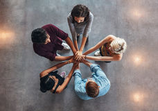 Young people making a stack of hands Stock Image
