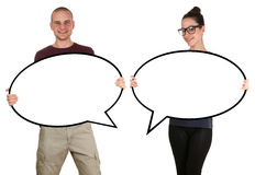 Young people man woman holding empty speech bubbles with copyspa Stock Images