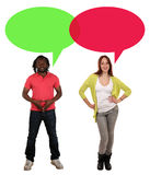 Young people man woman talking with speech bubble and copyspace Royalty Free Stock Images