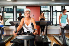 Young People And Mature Lady At The Gym Royalty Free Stock Images
