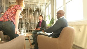 Young people meeting for a business deal stock video footage