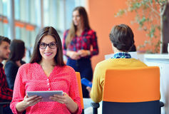 Young people meeting with digital tablet in startup office royalty free stock photos