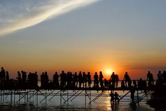 Young people meeting sunset. Many young people meeting sunset on sky background Stock Photography