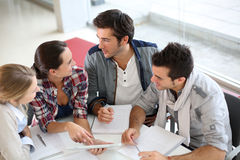 Young people meeting at table royalty free stock images