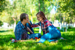 Young people. Young men and girl on walk in garden Stock Photography
