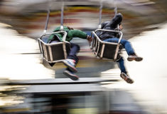 Young people on Merry Go Round at Lunapark Stock Image