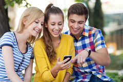 Young people with mobile phone Stock Photography
