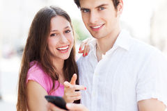 Young people with mobile phone Stock Images