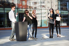 Young fashion people calling on cell phones outdoor Stock Images
