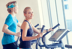 Young people in modern gym on the run simulator royalty free stock photography