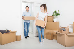Young people move into a new apartment. Royalty Free Stock Photography