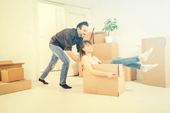 Young people move into a new apartment. Stock Images
