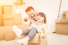 Young people move into a new apartment. Stock Image