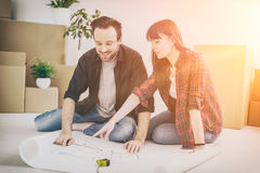 Young people move into a new apartment. Royalty Free Stock Photos