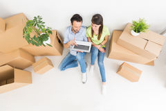 Young people move into a new apartment. Royalty Free Stock Photo