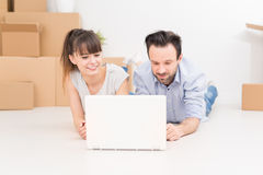 Young people move into a new apartment. Royalty Free Stock Images