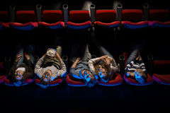 Young people in the movie theater Royalty Free Stock Photography