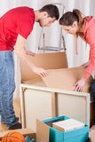 Young people moving house Royalty Free Stock Images
