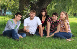 Young people on nature. Royalty Free Stock Photos