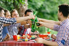 Young people in nature having fun and smiling stock photography