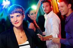 Young people in the nightclub. Young people, friends in the nightclub, dancing, having fun Stock Photo