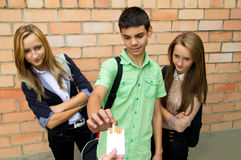 Young people offer cigarettes Royalty Free Stock Photo