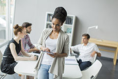 Young people in office Stock Photos