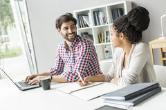 Young people in the office Stock Images
