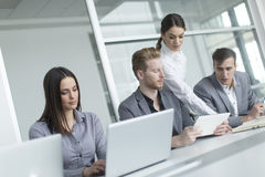 Young people in the office Royalty Free Stock Images