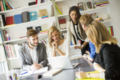Young people in the office Royalty Free Stock Photos