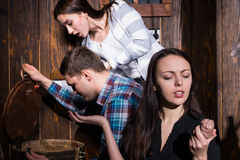 Young people opened a barrel and trying to solve a conundrum to. Get out of the trap, escape the room game concept Stock Photos
