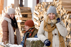 Young people outside winter cottage wooden logs royalty free stock image