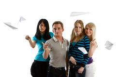 Young people with paper planes. Group of young happy people with paper planes on a white background Royalty Free Stock Photos