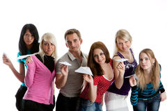 Young people with paper planes. Stock Image