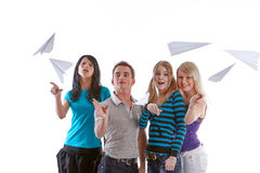Young people with paper planes. Group of young happy people with paper planes on a white background Stock Image