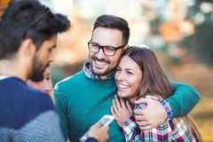 Young people in park with smart phone Stock Photography