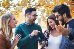 Young people in park with smart phone Stock Photos