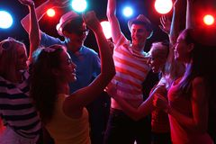 Young people at party. Young people having fun dancing at party Royalty Free Stock Image