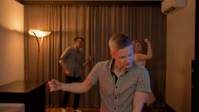 Young people partying, dancing and having fun at home party