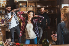 Young people partying. Drinking wine and having fun at home party Stock Photography