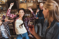Young people partying. Drinking wine and having fun at home party Royalty Free Stock Photography