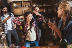 Young people partying. Drinking wine and having fun at home party Royalty Free Stock Image