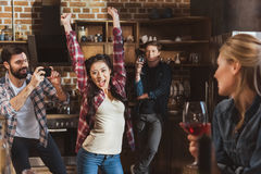 Young people partying. Drinking wine and having fun at home party Stock Photo