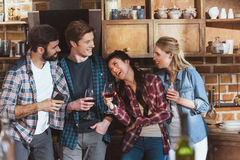 Young people partying. Drinking wine and having fun at home party Stock Photos