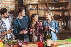 Young people partying. Drinking wine and having fun at home party stock images