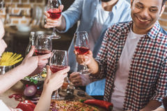 Young people partying at home. Young people partying, eating pizza and drinking wine at home party Stock Image