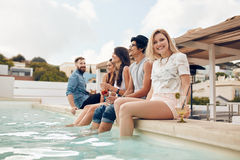 Young people partying by the poolside Royalty Free Stock Photo