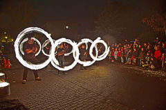 Young people perform a fire spectacle at night Stock Images