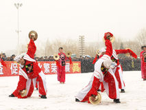Young people perform Yangge in the snow. People perform the traditional dance which name Yangge during Chinese New Year before Lantern Festival in north of Stock Image