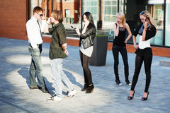 Young fashion people calling on the cell phones Stock Photography